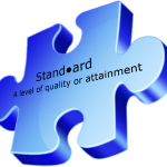 Jigsaw piece with a dictionary definition of a standard on it