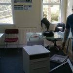New office. Team Psoda assembling furniture