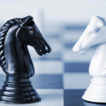 Black & white chess knights facing each other