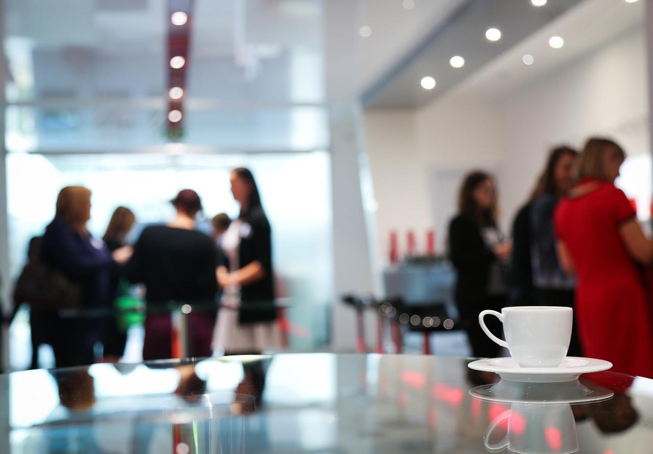 Conference delegates having coffee