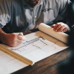 Construction training program. A man doing technical drawing